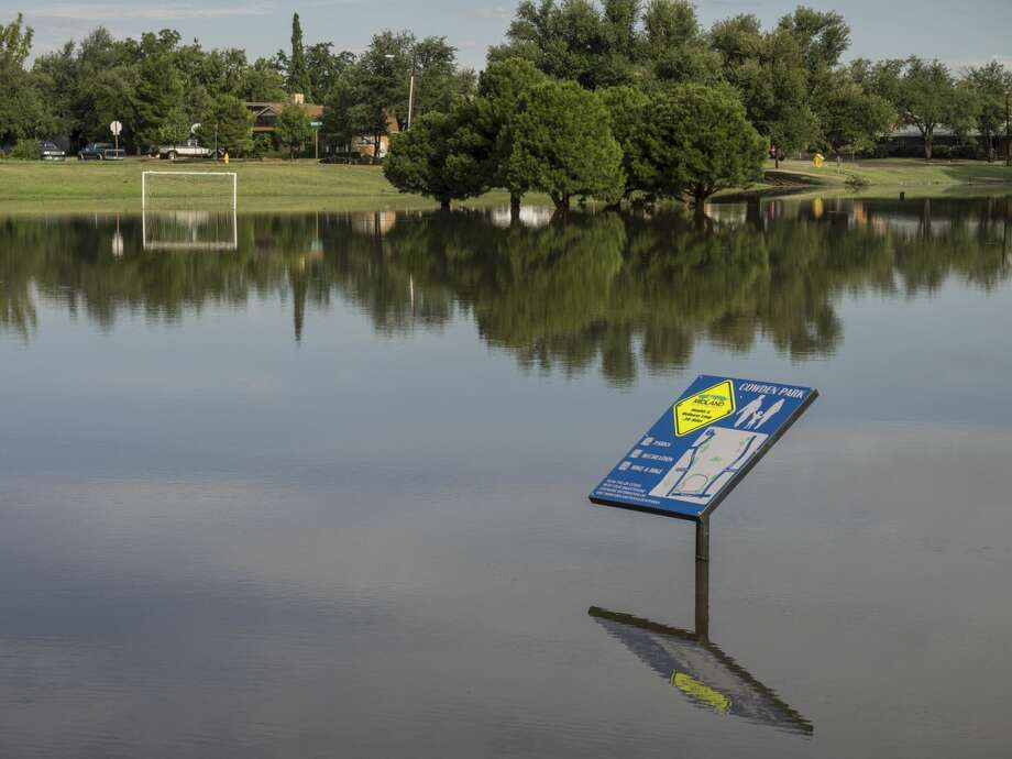Cowden Park walkway and soccer fields are full of run-off rain water 6/26/17. Tim Fischer/Reporter-Telegram Photo: Tim Fischer/Midland Reporter-Telegram