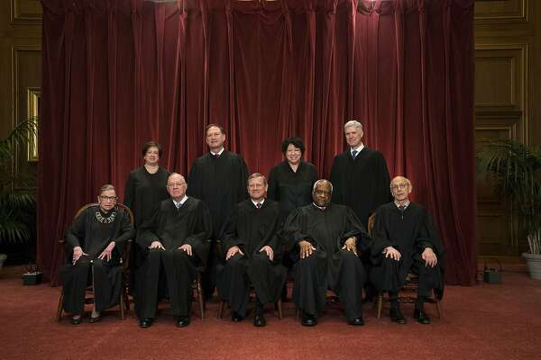 FILE-- The justices of the U.S. Supreme Court  sit for a group portrait in Washington, June 1, 2017. The court announced on June 26 that it will decide whether President Donald TrumpÕs revised travel ban was lawful, setting the stage for a major decision on the scope of presidential power. Front row, from left: Associate Justice Ruth Bader Ginsburg, Associate Justice Anthony Kennedy, Chief Justice John Roberts, Associate Justice Clarence Thomas, and Associate Justice Stephen Breyer. Back row, from left: Associate Justice Elena Kagan, Associate Justice Samuel Alito, Associate Justice Sonia Sotomayor and Associate Justice Neil Gorsuch. (Doug Mills/The New York Times)