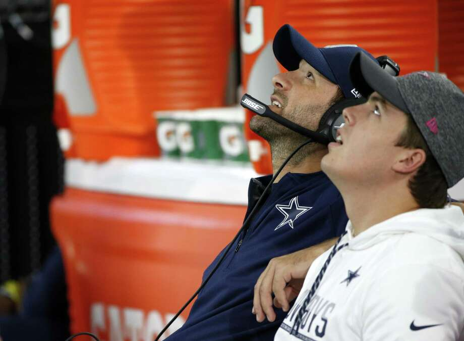 Dallas Cowboys quarterbacks Tony Romo (let) and Kellen Moore look up to the large video screen to watch play against the Cincinnati Bengals on Oct. 9, 2016, in Arlington. Photo: Ron Jenkins /Associated Press / FR171331 AP