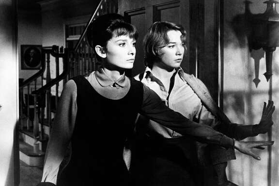 British actress Audrey Hepburn (Audrey Kathleen Ruston) and American actress Shirley MacLaine (Shirley MacLean Beaty) acting in The Children's Hour. USA, 1962. (Photo by Mondadori Portfolio via Getty Images)