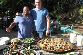 Man Fire Food host Roger Mooking (left) made a stop at The Bin to talk paella with San Antonio chef Jason Dady. The episode featuring their exploits will air 8 p.m. July 4 on the Cooking Channel.