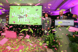 Confetti showers audience members as Howard Hughes' Tim Welbes, The Woodlands Development Company President, and Heath Melton, Howard Hughes Vice President of Master Planned Communities, Residential Development, reveal The Woodlands Hills master communityon Monday, June 26, 2017, at The Westin at The Woodlands.