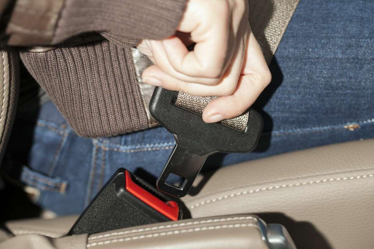 Woman fastening seat belt (Photo by Bildquelle/ullstein bild via Getty Images)