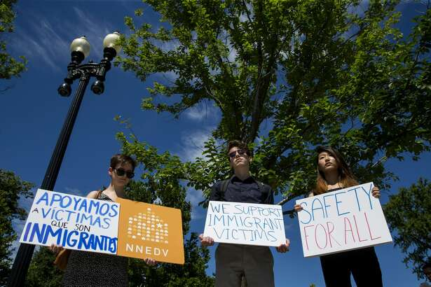 People protest outside the U.S. Supreme Court after it was announced that the court will allow a limited version of President Donald Trump's travel ban to take effect June 26, 2017 in Washington, DC. The Supreme Court will consider the case of the president's power on immigration in the fall but in the meantime agreed to allow a limited ban on travelers from six mostly Muslim countries to take effect.  (Photo by Eric Thayer/Getty Images)