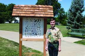 Edwardsville High School senior-to-be Zachary Keiser stands next to his completed Eagle Scout project Saturday at Glik Park. Keiser is a member of Troop 226 and the son of Mike and Laura Keiser. His project features a bird identification chart on one side and a fish identification chart on the other. Keiser said it took five days to build the kiosk.
