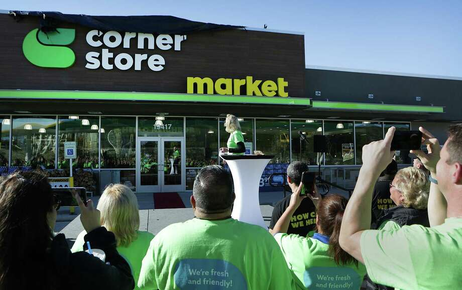 As part of winning antitrust approval for its $4.4 billion acquisition of San Antonio-based CST Brands Inc., Quebec-based Alimentation Couche-Tard Inc. has agreed to sell 70 of CST's Corner Store locations — including 19 in Texas — to Dallas-based Empire Petroleum Partners. In this 2015 photo, CST employee gathered for the unveiling of a new Corner Store at 19417 Babcock Road. Photo: San Antonio Express-News File Photo / San Antonio Express-News
