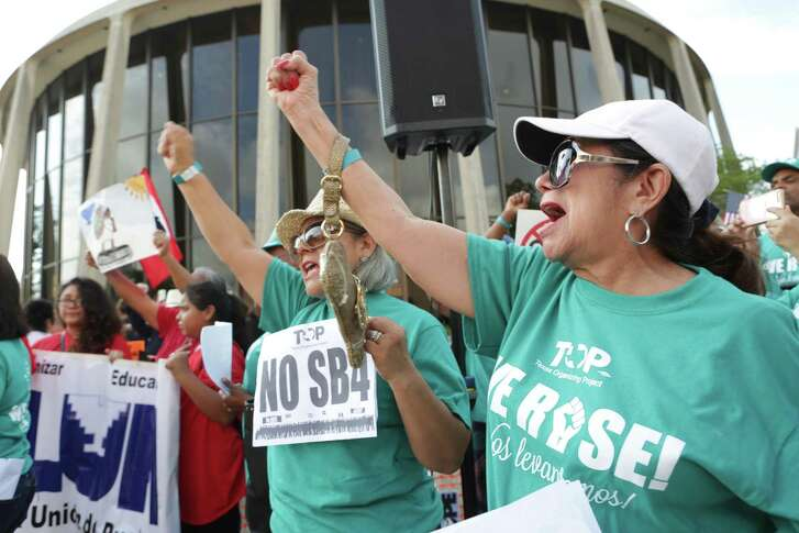 Protestors gather in front of the Federal Courthouse in San Antonio to voice their opposition to SB 4, on Monday June 26, 2017.