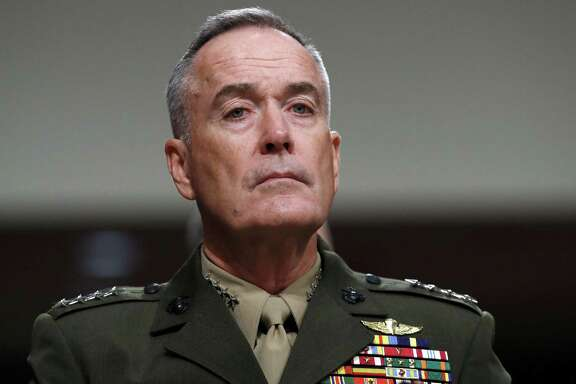 Gen. Joseph Dunford heads the Joint Chiefs of Staff. His service chiefs want to delay the enlist- ment of transgender troops.