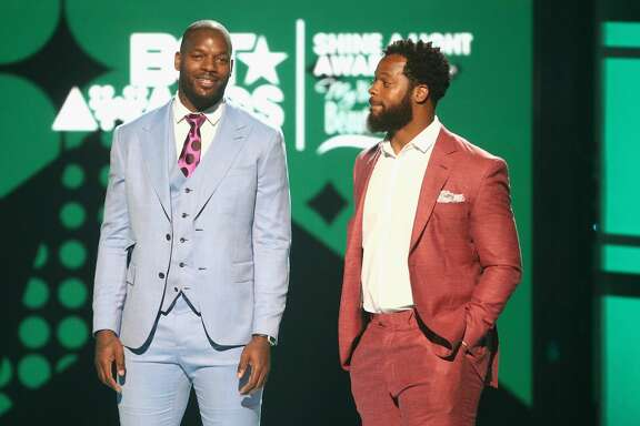 LOS ANGELES, CA - JUNE 25:  Martellus Bennett and Michael Bennett speak onstage at 2017 BET Awards at Microsoft Theater on June 25, 2017 in Los Angeles, California.  (Photo by Frederick M. Brown/Getty Images )
