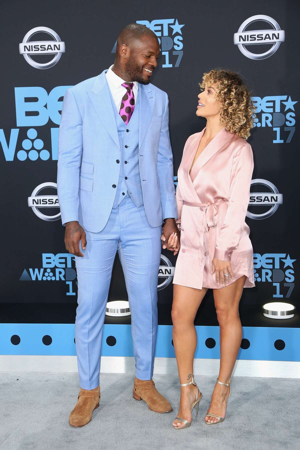 LOS ANGELES, CA - JUNE 25: Martellus Bennett (L) and Siggi Walker at the 2017 BET Awards at Microsoft Square on June 25, 2017 in Los Angeles, California. (Photo by Maury Phillips/Getty Images)