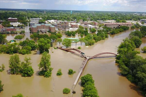 The Tittabawassee River reaches 32.15 feet in Midland on Saturday.