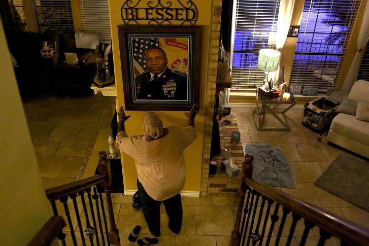 Katherine Turner adjusts a photo of her husband, Sgt. Maj. Wardell Turner, at her home in San Antonio on February 19, 2017.