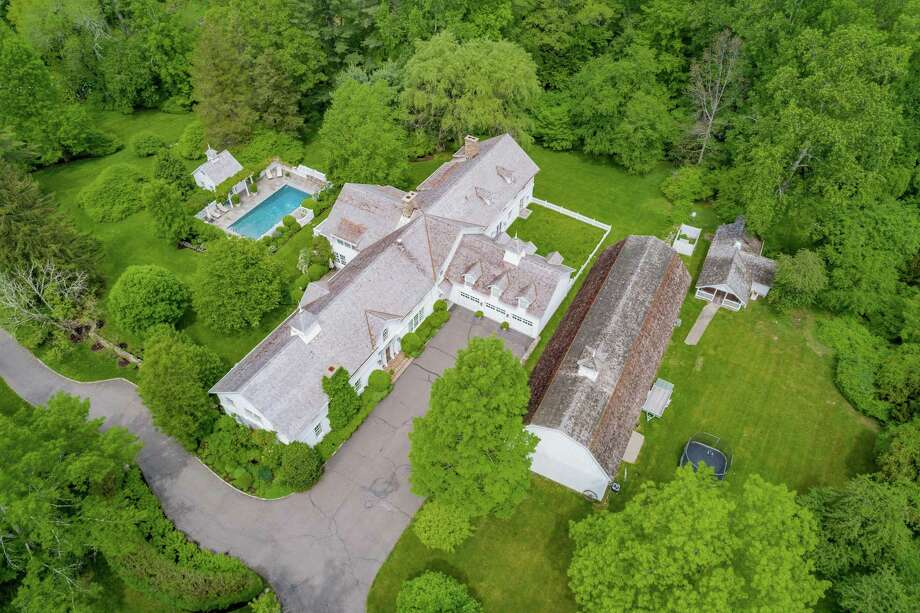 The converted and updated antique dairy barn in which Harry Connick Jr. and his wife Jill raised their three children sits on a 4.61-acre estate along with a second barn, a heated in-ground swimming pool, pool house, and guest cottage.