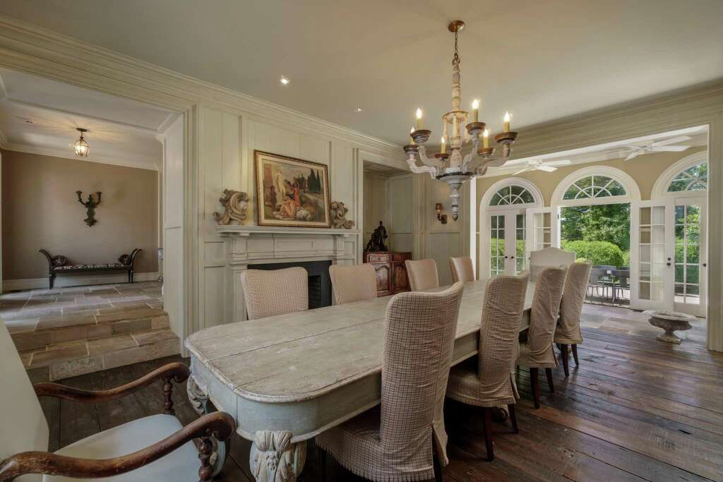The Formal Dining Room Has Wide Planked Wood Floors A Decorative Rather Than Functional