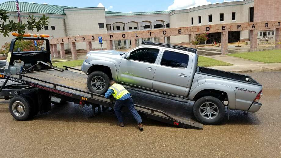 When police checked the Toyota Tacoma the suspect arrived in, police found two juveniles inside the vehicle allegedly rolling papers. Photo: Cesar Rodriguez/Laredo Morning Times