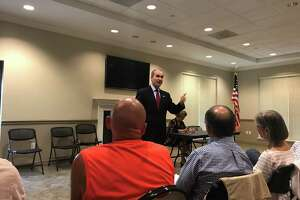 District 132 state Rep. Mike Schofield, R-Katy, speaks to constituents at a town hall meeting in Cypress on June 21.