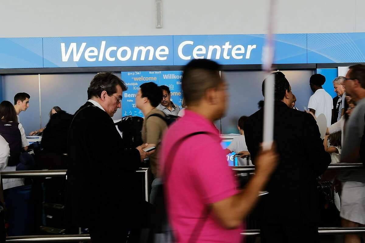 NEW YORK, NY - JUNE 26: People walk through international arrivals at terminal four at John F. Kennedy (JFK) airport following an announcment by the Supreme Court that it will take President Donald Trump's travel ban case later in the year on June 26, 2017 in New York City. The court will let a limited version of the travel ban from six mostly muslim countries take effect before hearing full arguments in October. (Photo by Spencer Platt/Getty Images)