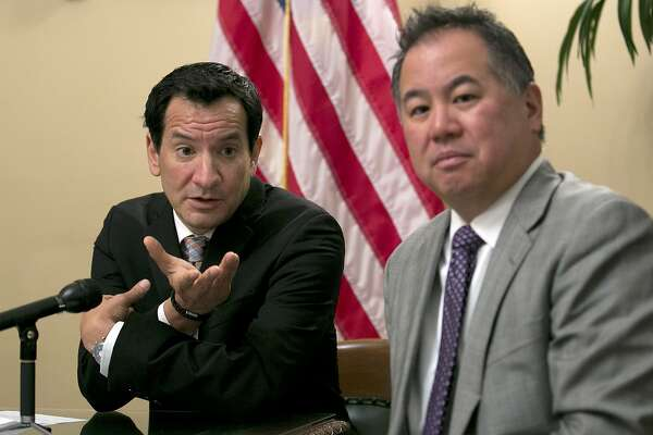 Assembly Speaker Anthony Rendon, D-Paramount, left, accompanied by Assembly budget chair Phil Ting, D-San Francisco, responds to a question concerning the state budget agreement reached between Gov. Jerry Brown and Democratic lawmakers, Tuesday, June 13, 2017, in Sacramento, Calif. (AP Photo/Rich Pedroncelli)