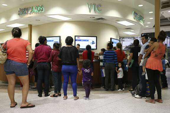 In this 2014 photo, recently released immigrants from Central American line up to receive bus tickets at the terminal in McAllen. McAllen was one of the areas hit the hardest by the influx of immigrants, a majority of whom were unaccompanied minors and families. McAllen Mayor Jim Darling estimates McAllen alone ran up a bill of $700,000 on bus services, security and facilities for the people.