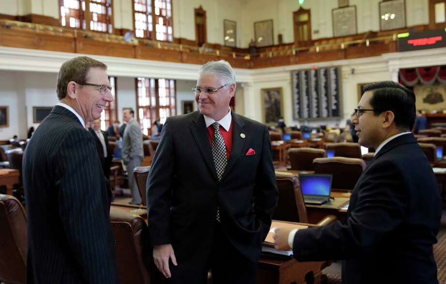 Rep. Dan Huberty, R-Houston, center, talks with Rep. Byron Cook, R-Corsicana, left, and Rep. Diego Bernal, D-San Antonio, right, on the house floor Wednesday, April 19, 2017, in Austin, Texas. Huberty, Chair of the House Public Education Committee, is the sponsor of House Bill 21 which would put money into the school system. (AP Photo/Eric Gay) Photo: Eric Gay, STF / Copyright 2017 The Associated Press. All rights reserved.