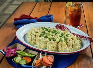 The Pit Room's Mustard Potato Salad is a classic option. Place setting, glass and serving spoon available at Kuhl-Linscomb, 2424 W. Alabama. Recipe, page D4