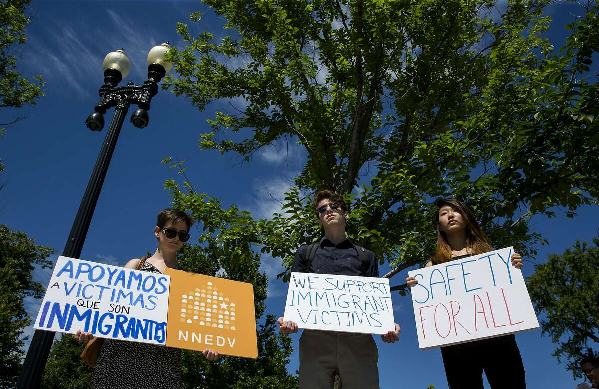 WASHINGTON, DC - JUNE 26: People protest outside the U.S. Supreme Court after it was announced that the court will allow a limited version of President Donald Trump's travel ban to take effect June 26, 2017 in Washington, DC. The Supreme Court will consider the case of the president's power on immigration in the fall but in the meantime agreed to allow a limited ban on travelers from six mostly Muslim countries to take effect. (Photo by Eric Thayer/Getty Images)