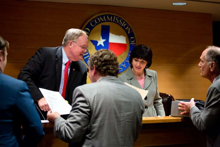 Railroad Commissioner Wayne Christian and Chairman Christi Craddick sign orders after a commissioners' conference in May. The agency's biennial budget was increased by 46 percent from $176.5 million to $256.1 million in the recently ended legislative session.