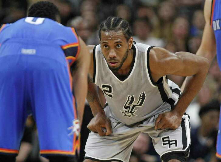 Kawhi Leonard of the Spurs focuses on his defense against the Oklahoma City Thunder's Russell Westbrook at the AT&T Center on March 12, 2016 in San Antonio.
