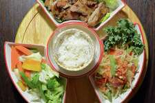 Som Tum Set, a sampling of Papaya salad, grilled pork or chicken and sticky rice, features on the menu in the new InThai Restaurant at 83 Atlantic St., in downtown Stamford, Conn.