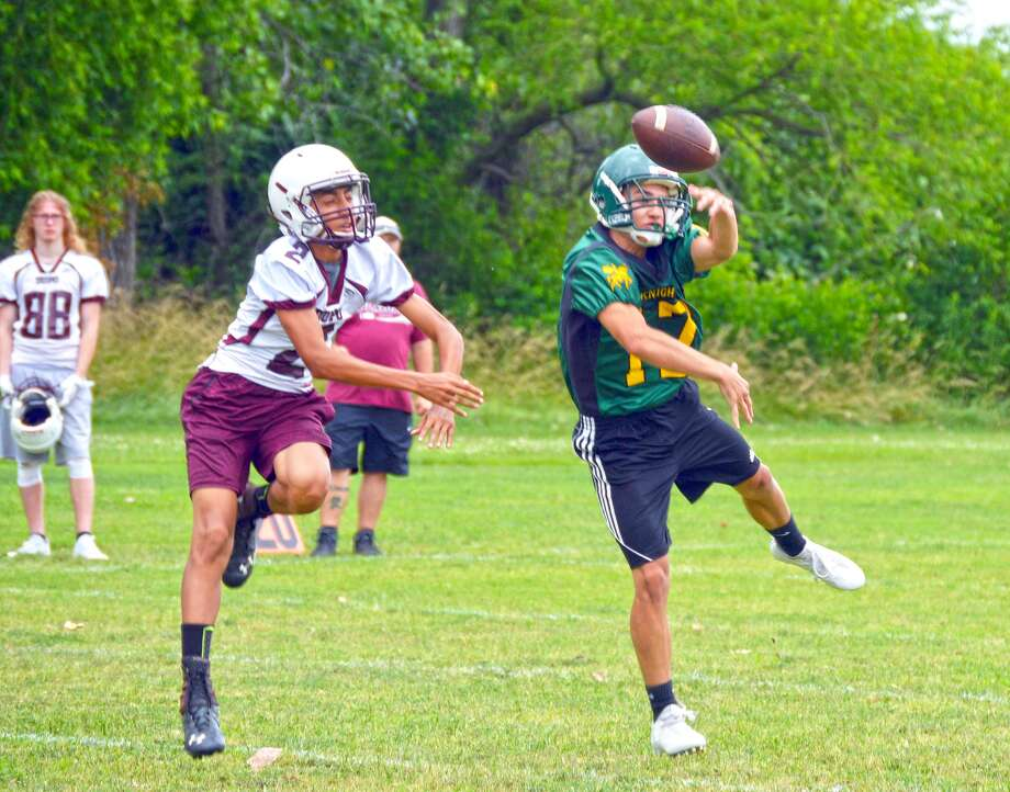 Metro-East Lutheran defensive back Eli Harding, right, knocks away a pass intended for a Dupo wide receiver during a scrimmage on Thursday.