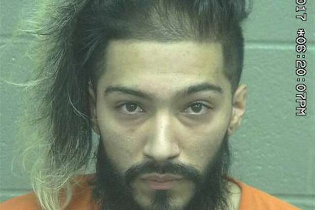 Ismael Alejandro Carrasco, 21,was arrested Sunday after he allegedly pushed a man onto a coffee table containing decorative pieces, according to court documents.