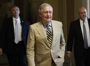 "Senate Majority Leader Mitch McConnell of Ky. walks from his office on Capitol Hill in Washington, Monday, June 26, 2017. Senate Republicans unveil a revised health care bill in hopes of securing support from wavering GOP lawmakers, including one who calls the drive to whip his party's bill through the Senate this week ""a little offensive."" (AP Photo/Carolyn Kaster)"