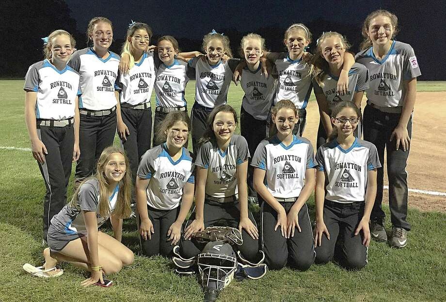 The Rowayton Little League girls 12-year-old softball team poses for a photo after winning their second game of the week during the District 1 tournament, which started last week. Rowayton went 2-1 and has two more games to play. Photo: John Nash / Hearst Connecticut Media / Norwalk Hour