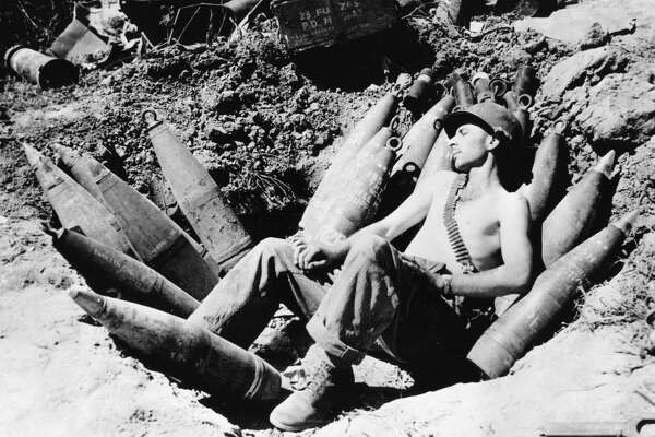 circa 1950:  An American soldier sleeps on his ammunition in the Mason area during the Korean war.  (Photo by Keystone/Getty Images)