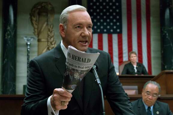 "This image released by Netflix shows Kevin Spacey in a scene from ""House Of Cards."" Writing TV shows based on real life in Washington has always been a challenge. But since Donald Trump became president, writers of such series as ""Madam Secretary,"" ""House of Cards"" and ""Veep"" say their job is tougher than ever. The twists and turns of the Trump Administration keep the writers on their toes as they attempt to create their own make-believe plot twists that won't seem dull by comparison. (David Giesbrecht/Netflix via AP)"