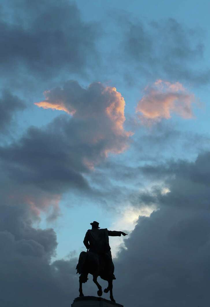 On the first day of fall, the statue of Gen. Sam Houston seems to point to a opening in the clouds before rain moved into the metro area Thursday, Sept. 22, 2016, in Houston. ( Steve Gonzales  / Houston Chronicle )