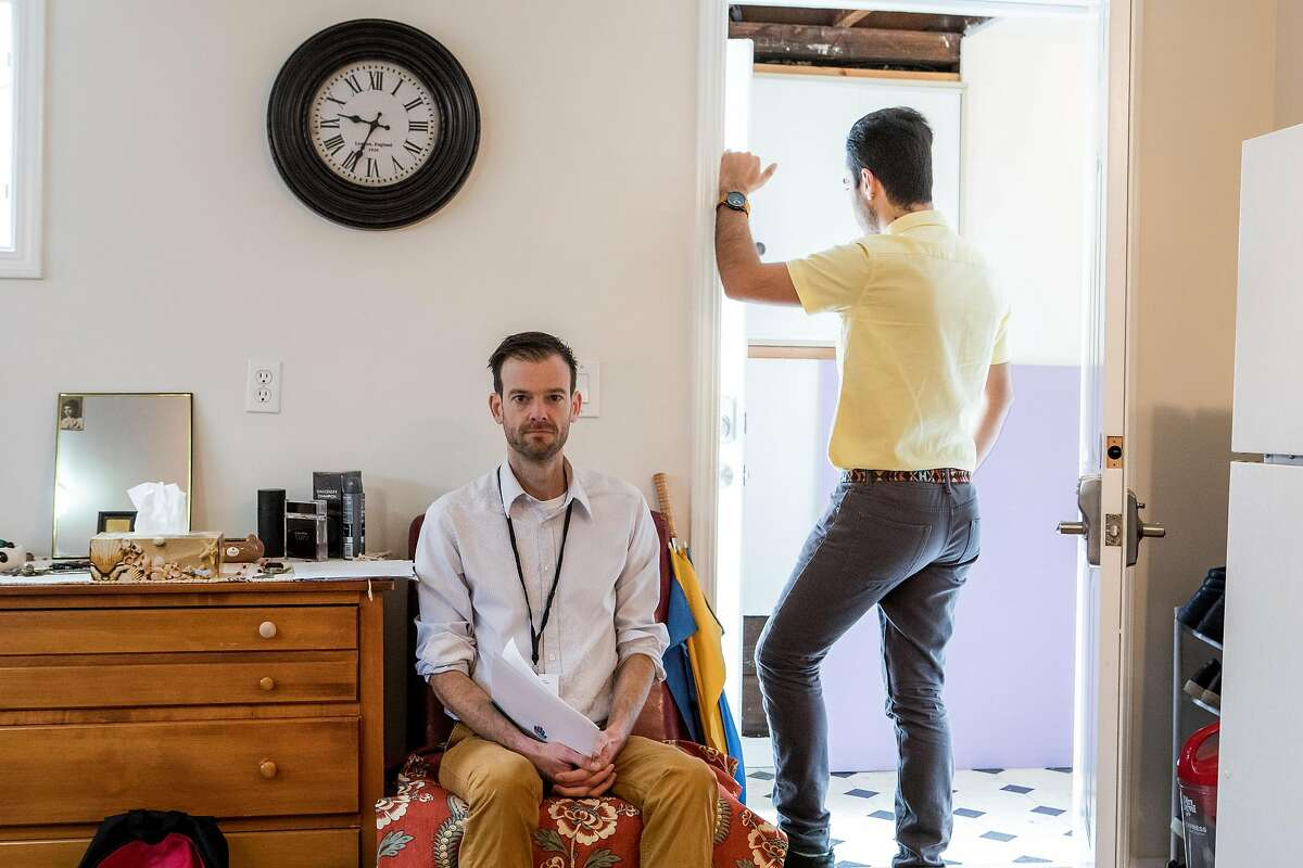 Wade Meyer, LGBT refugee services coordinator at the Jewish family and community services, and Amir, a gay refugee from Iran, sit for a portrait in Amir�s home on February 3, 2017. Amir made it to the U.S. in the recent weeks, while his close friend remains stuck in Turkey.
