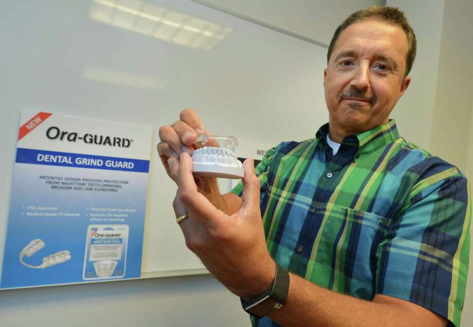 Bite Tech CEO Jeff Padovan holds one of the companies newest products, the Ora-Guard Dental Grind Guard, designed to prevent nighttime teeth grinding, on Wednesday June 21, 2017 in Norwalk Conn. Photo: Alex Von Kleydorff / Hearst Connecticut Media / Norwalk Hour