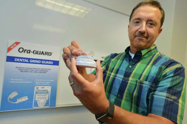 Bite Tech CEO Jeff Padovan holds one of the companies newest products, the Ora-Guard Dental Grind Guard, designed to prevent nighttime teeth grinding, on Wednesday June 21, 2017 in Norwalk Conn.