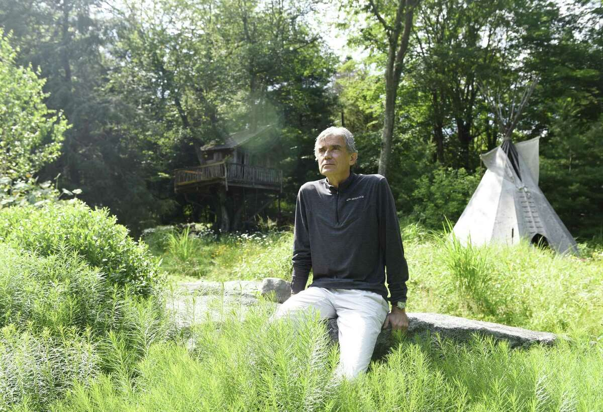 Scientist and explorer Luc Hardy poses outside his home in the Cos Cob section of Greenwich on Monday. Hardy has captained many climate change-themed scientific excursions and plans to go to Cuba and Russia later this year.