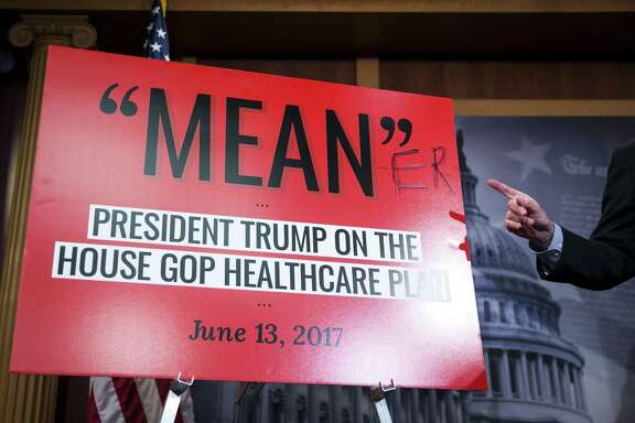 Senate Minority Leader Chuck Schumer edits a quote attributed to President Donald Trump to comment on the release of Senate Republicans' health care legislation on Capitol Hill Thursday. A Congressional Budget Office analysis is pending but Democrats say this bill is meaner than the House's measure.