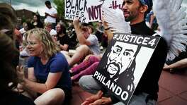 Protesters gather on June 18 in St. Anthony, Minn. for a memorial rally in honor of Philando Castile. A jury acquitted officer Jeronimo Yanez in the shooting.