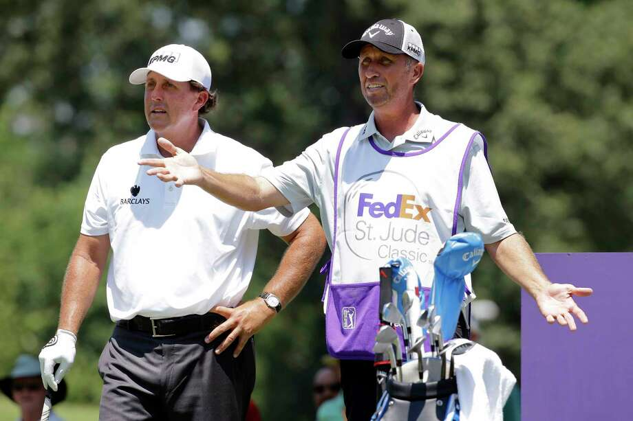 "FILE - In this June 11, 2015, file photo, Phil Mickelson, left, talks with his caddie Jim Mackay on the eighth tee during the first round of the St. Jude Classic golf tournament in Memphis, Tenn. Mickelson and his caddie have decided to part ways after 25 years of one of the most famous player-caddie relationships on the PGA Tour. Mickelson and Jim ""Bones"" Mackay say the decision to split was mutual and not based on an incident. (AP Photo/Mark Humphrey, File) Photo: Mark Humphrey, STF / Copyright 2016 The Associated Press. All rights reserved. This material may not be published, broadcast, rewritten or redistribu"