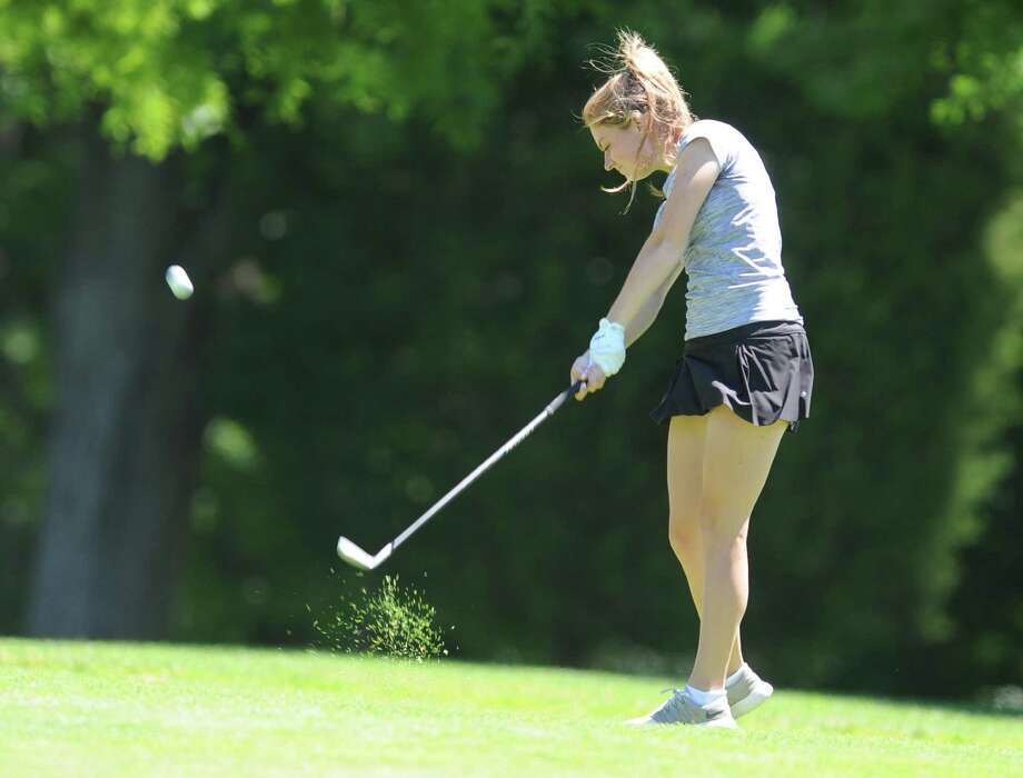Catherine McEvoy hits an approach shot during the Greenwich Women's Town Golf Tournament at Griffith E. Harris Golf Course in Greenwich, Conn. Monday, June 26, 2017. Catherine McEvoy won the townwide division, Laurabeth Rodgers and Irene Lok tied the senior division, and Yanna Saari won the super-senior division. Photo: Tyler Sizemore / Hearst Connecticut Media / Greenwich Time