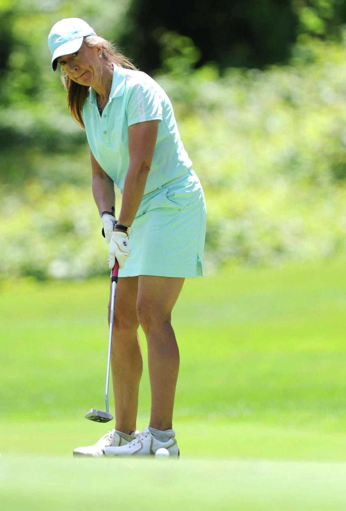 Laurabeth Rodgers putts during the Greenwich Women's Town Golf Tournament at Griffith E. Harris Golf Course in Greenwich, Conn. Monday, June 26, 2017. Catherine McEvoy won the townwide division, Laurabeth Rodgers and Irene Lok tied the senior division, and Yanna Saari won the super-senior division.