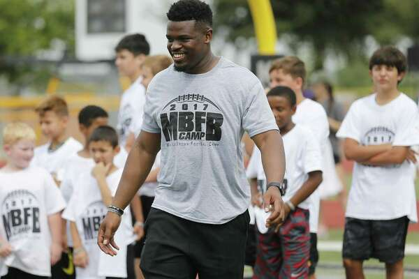Former Steele High School, University of Texas football star Malcolm Brown who now plays for the Los Angeles Rams holds his first ever youth football camp at Steele High School on Saturday, June 24, 2017. (Kin Man Hui/San Antonio Express-News)