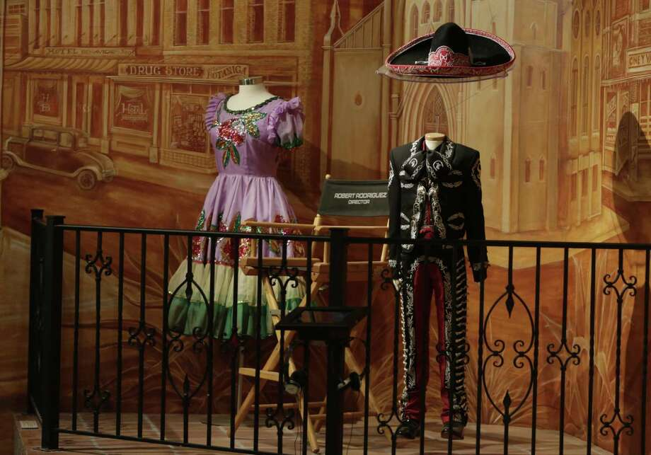 The Institute of Texan Cultures has its share of modern artifacts, such as the mariachi jacket of San Antonio performer Sebastien de la Cruz, a handmade stage dress by celebrated singer and 12-string guitarist Lydia Mendosa and a director's chair used by famous filmmaker and San Antonio native Robert Rodriguez. Photo: Srijita Chattopadhyay /San Antonio Express-News / © 2017 San Antonio Express-News