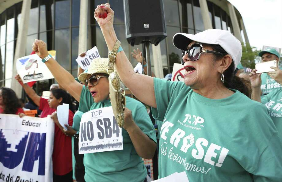 Lydia Baldera, right, and Maria Lira, left, of Houston yell chants as protestors hold a rally in front of the Federal Courthouse in San Antonio, Tx against SB 4 on June 26, 2017. Photo: Bob Owen /San Antonio Express-News / ©2017 San Antonio Express-News