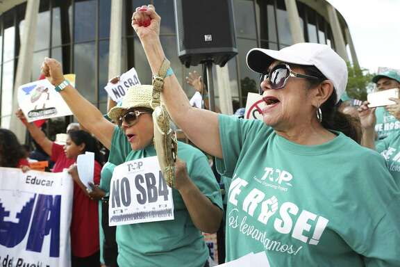 Lydia Baldera, right, and Maria Lira, left, of Houston yell chants as protestors hold a rally in front of the Federal Courthouse in San Antonio, Tx against SB 4 on June 26, 2017.