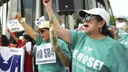 Lydia Baldera, right, and Maria Lira, left, of Houston TX, yell chants as protestors hold a rally in front of the Federal Courthouse in San  Antonio, Tx against SB 4 on Monday, June 26, 2017.